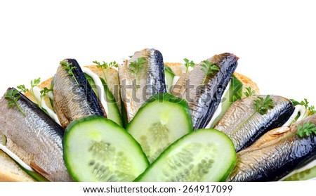 Sprats sandwiches, appetizer on plate isolated on white - stock photo