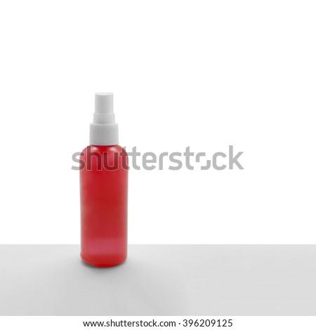 spray bottle on a white background - stock photo