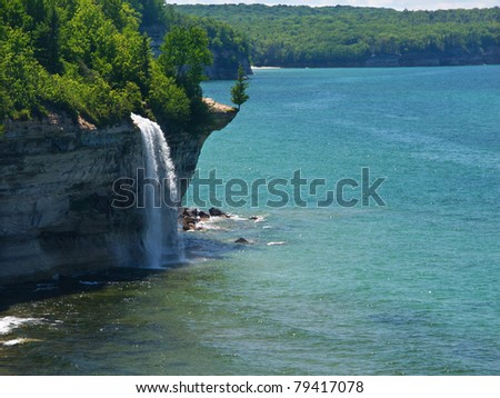 Spray Falls plunges into Lake Superior at Pictured Rocks National Lakeshore, Michigan - stock photo