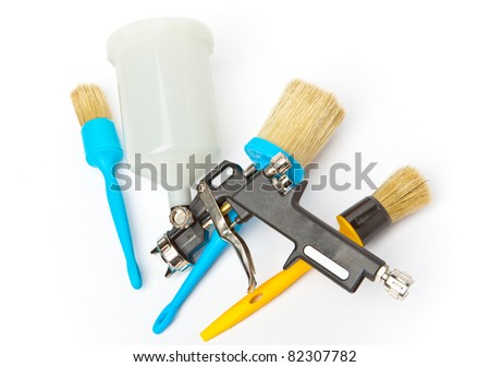 spray gun and brushes - a set for repair work - stock photo