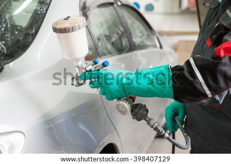 spray gun with paint for painting a car  - stock photo