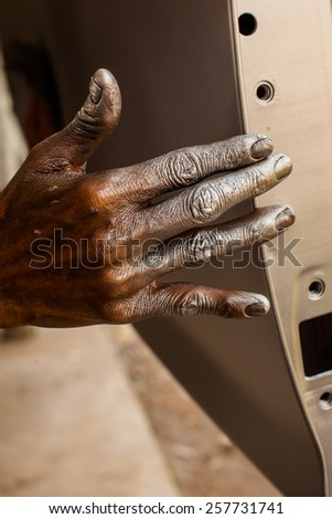 Spray paint stained hands - stock photo