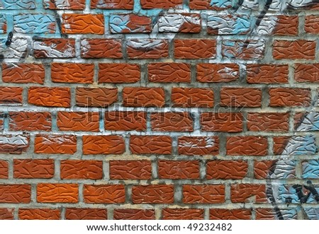 spray painted brick wall - stock photo