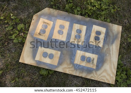 spray painting electrical outlet covers - stock photo