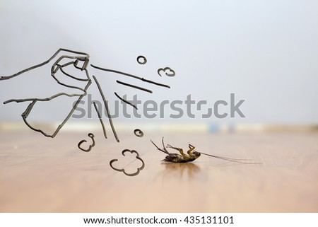 Spray to cockroach on floor , pest control concept - stock photo
