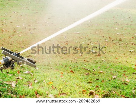 Spray water with high pressure from big sprinkler  - stock photo