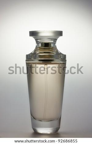 Spray with perfume. Vial of perfume. - stock photo
