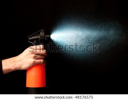 sprayer in action - stock photo