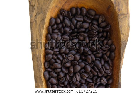 Spread coffee seeds on wooden spoon  isolated on white background