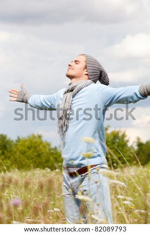 spread his arms in autumn - stock photo