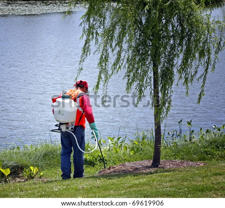 Spreading chemicals on lawn - stock photo