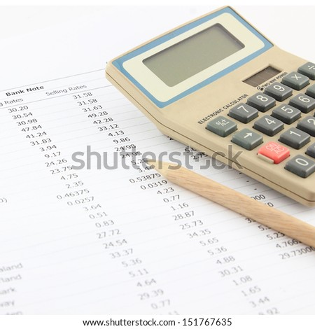 spreadsheet with pen and calculator. - stock photo