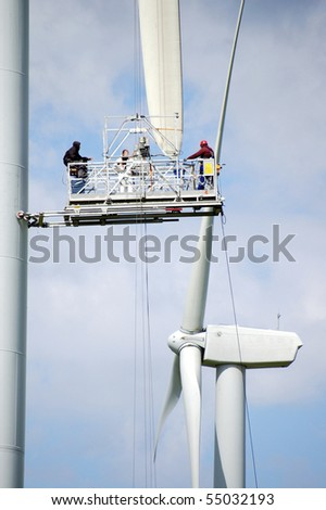 Sprenge, Germany - 09-2009: Some workers doing some repairs to a wind generator in Sprenge, Germany, near Kiel - stock photo