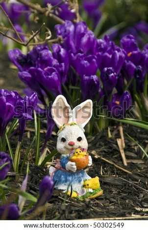 Sprig flowers and Easter bunny - stock photo