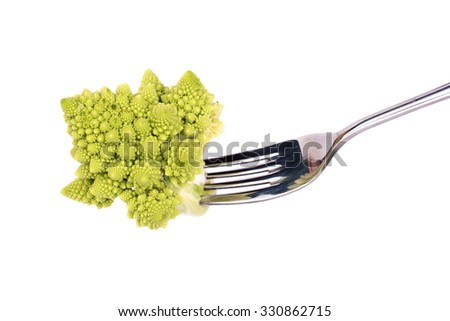 Sprig of fresh Romanesco cabbage on the fork close-up