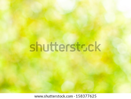 Spring abstract background, blurred sun light - bokeh. Green, yellow and white dots. - stock photo