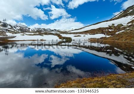Spring alps mountain lake Lago della Piazza (Switzerland, Passo del San Gottardo) - stock photo