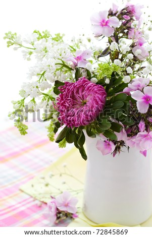 Spring arrangement of aster,phlox and lilac - stock photo