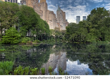 Spring at the pond in Central Park, New York City with Gapstow bridge in the background - stock photo