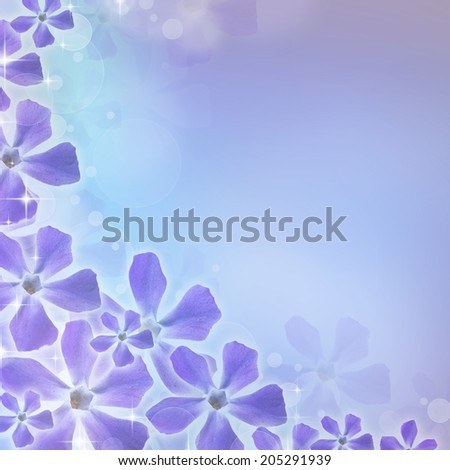 Spring background with periwinkle flower - stock photo