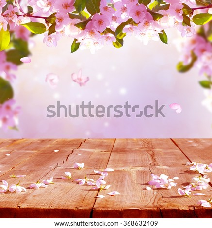 spring background with wooden table - stock photo