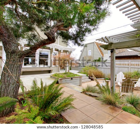 Spring backyard with garden beds and wood structures. - stock photo