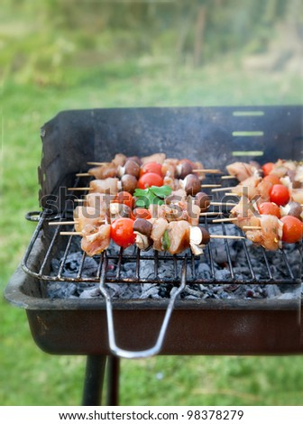 Spring barbecue: Chicken and vegetables barbecue in the garden - stock photo