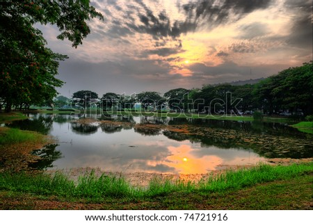 spring beautiful sunset landscape with HDR - stock photo