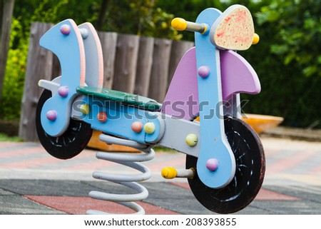 Spring bicycle on a playground - stock photo