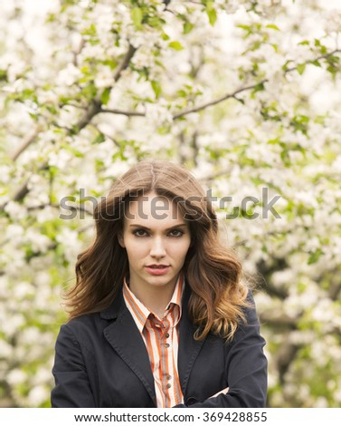 Spring blooming , outdoor shot of a beautiful girl  - stock photo
