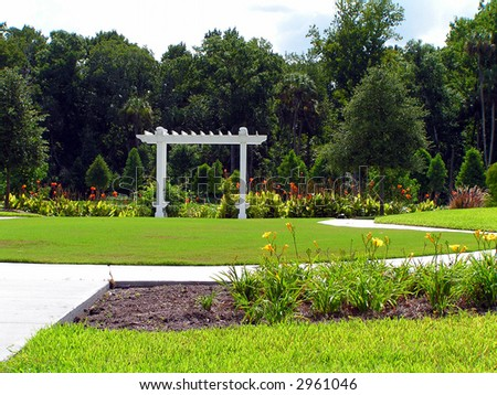spring blooms in the park with white trellis - stock photo