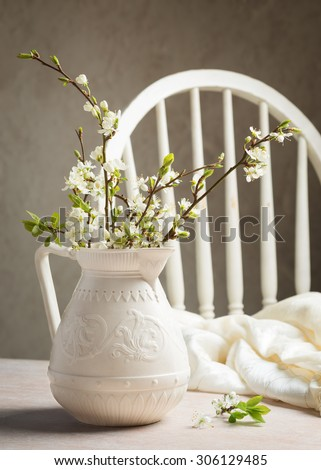 Spring blossom in antique jug still life