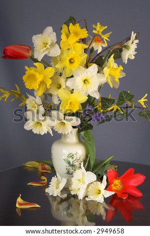 Spring. Bouquet of flowers on a table in a living room - stock photo