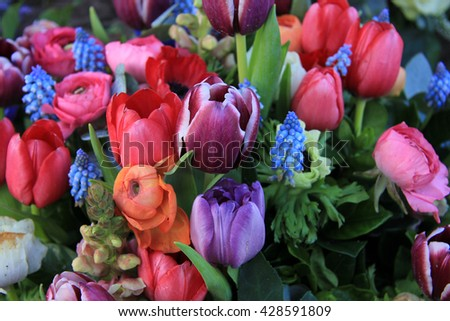 Spring bouquet with ranunculus, tulips and anemones in bright colors