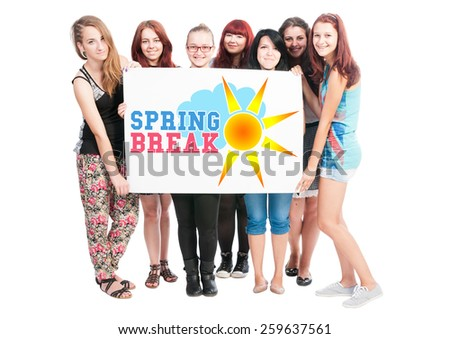 Spring break text illustration concept wrote on big white card hold by teen girls - stock photo
