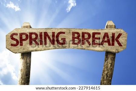 Spring Break wooden sign on a summer day - stock photo