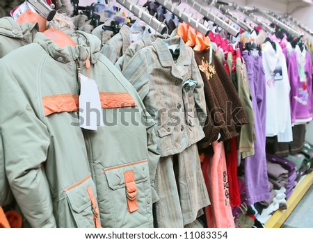 spring children's clothes in a store - stock photo