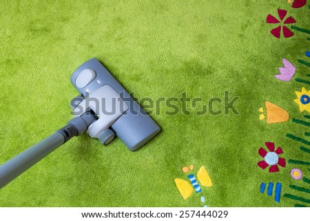 Spring cleaning, Modern living room, with a vacuum cleaner to tidy up - stock photo