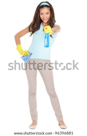 Spring cleaning woman pointing cleaning spray bottle. Beautiful cleaning girl standing in full body isolated on white background. Mixed race Caucasian / Asian Chinese woman having fun spring cleaning. - stock photo