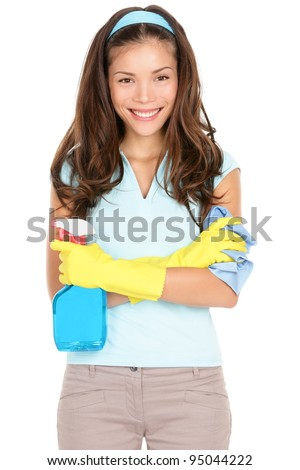 Spring cleaning woman ready for spring cleaning smiling with rubber gloves and cleaning products. Pretty smiling young mixed race Asian / Caucasian girl isolated on white background. - stock photo