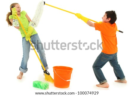 Spring cleaning 9 year old kids playing with stinky mop over white background barefoot in casual.