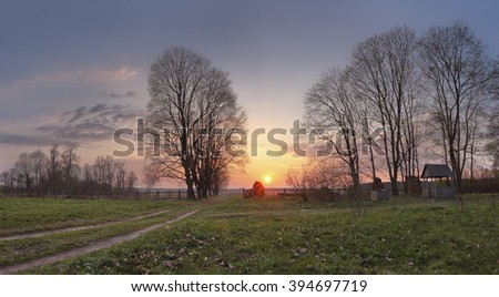 Spring countryside sunset. Old country road in the park. Belarus