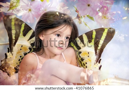 Spring fairy on pink blossom chery tree - stock photo