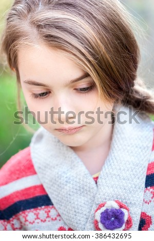 Spring fairy. Portrait of beautiful little girl with brownish blond hair and blue eyes standing outdoor on natural background. - stock photo