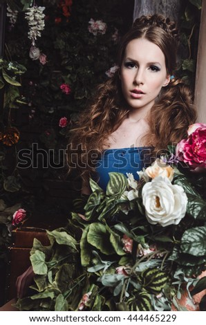 Spring fashion girl outdoors portrait in blooming dark garden. Beauty Romantic woman in flowers. Sensual Lady. Beautiful Woman Enjoying Nature. Romantic beauty in fantasy orchard. Studio portrait. - stock photo