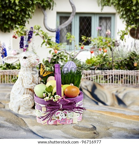 Spring Flowers In English Beach Cottage  ~ Beautiful Spring or Easter Scene With Espalier Apple Tree, Wicker Fence and Enchanted Garden - stock photo