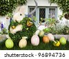 Spring Flowers In English Beach Cottage  ~ Beautiful Spring or Easter Scene With, Rabbit, Painted Eggs, Espalier Apple Tree, Wicker Fence and Enchanted Garden - stock photo