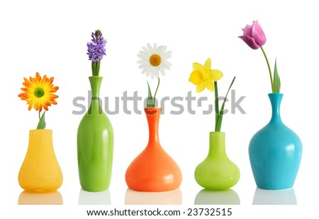 Spring flowers in vases isolated on white - stock photo