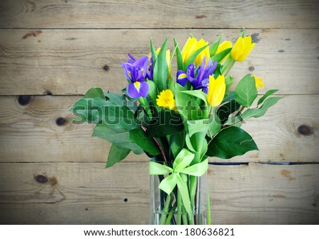 spring flowers on the wooden background. - stock photo