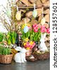 spring flowers with easter bunny and eggs decoration. tulips, snowdrops and narcissus blooms on white background - stock photo